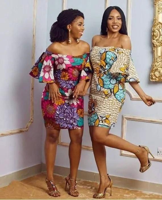 2 ladies wearing ankara short gowns