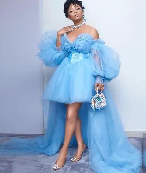 Toke Makinwa wearing a sky blue short dress with billowy sleeves