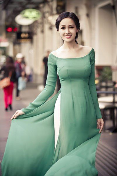 busty lady in boat neck green dress