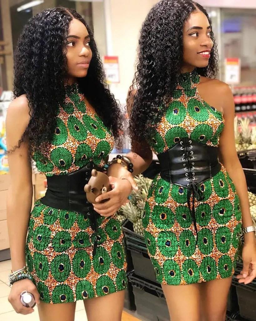identical twins rocking identical ankara short gowns