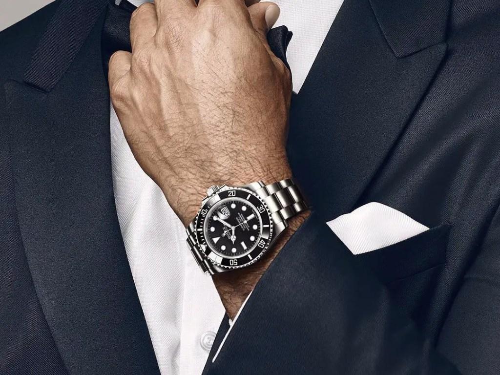 man in suit wearing a simple wristwatch