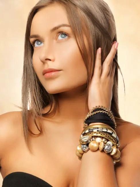 woman wearing bracelets - Types of Jewelry Every Woman Should Own