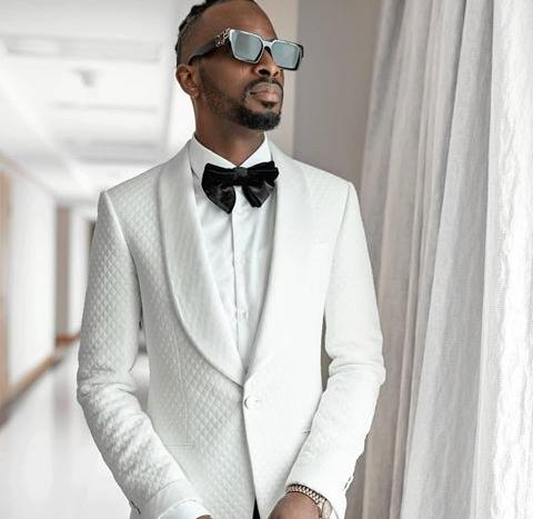 White suit by Atafo - Top Fashion Brands in Nigeria