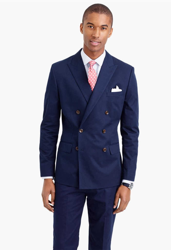navy blue double breasted suit on a handsome black man