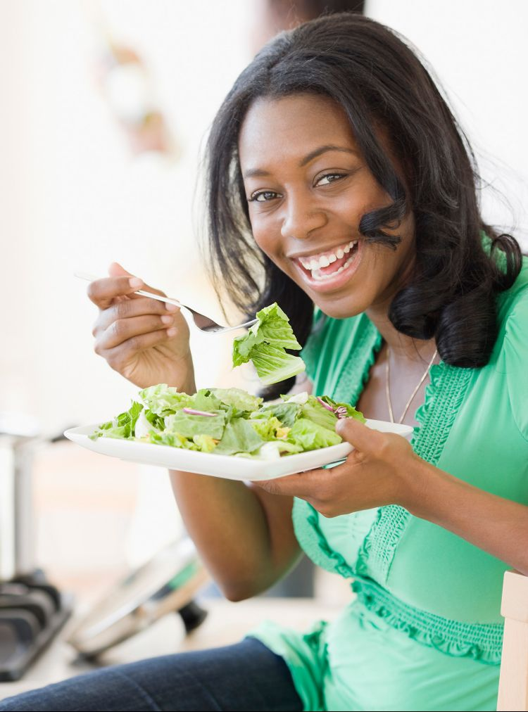 African woman eating
