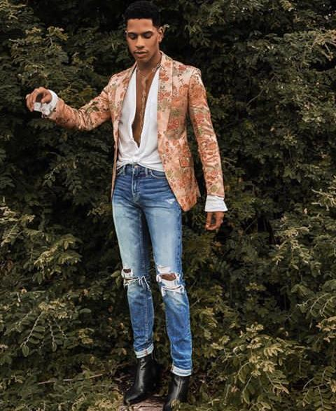 Denola Grey in flowered suit and skinny blue ripped jeans