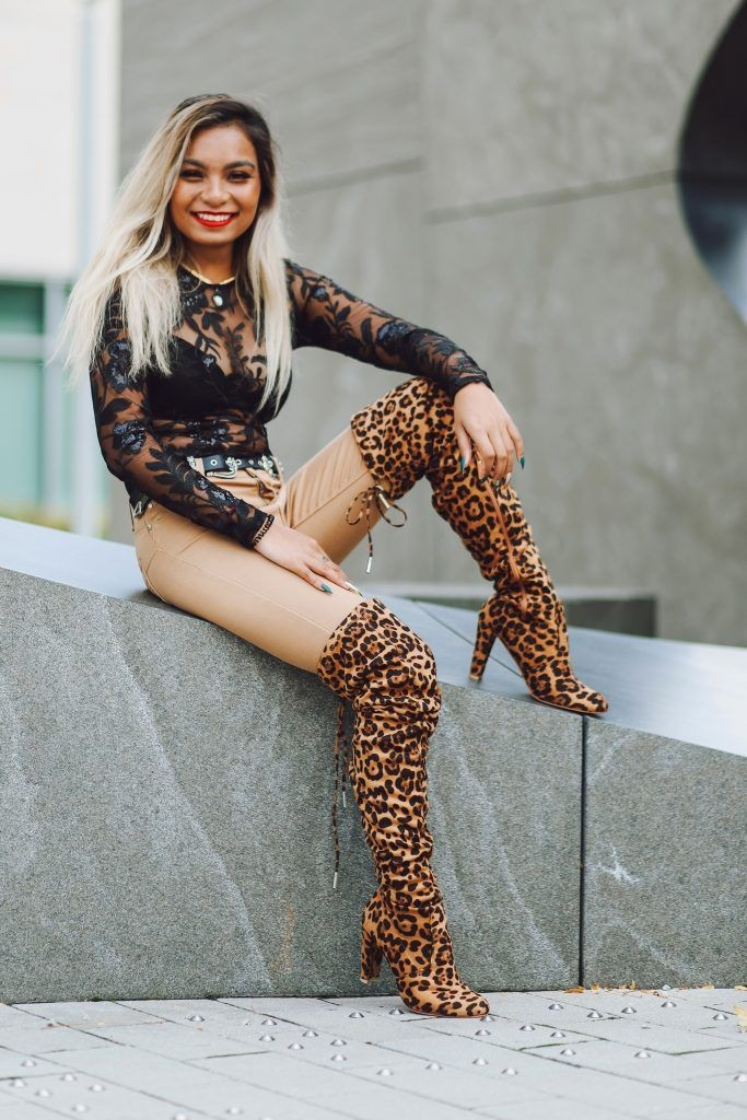 lady rocking leopard design over-the-knee boots with heels