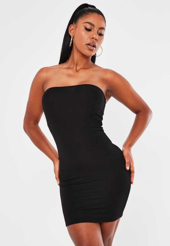 woman in a black bodycon dress