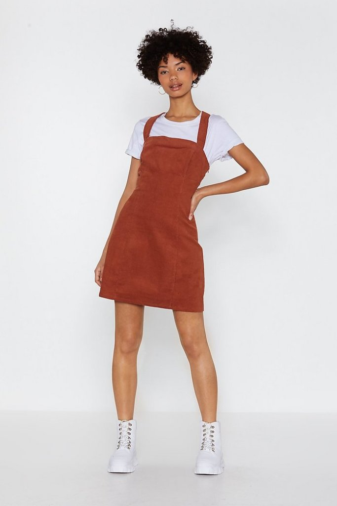 lady in brown pinafore dress and white tshirt