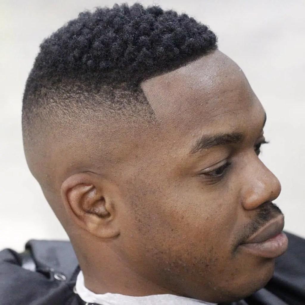 high bald fade haircut on an African man