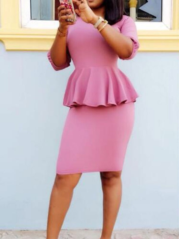 lady in a pink peplum dress - 15 Must-have Types of Dresses for Women