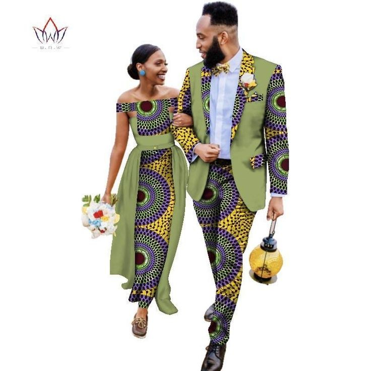 man in ankara suit walking with his woman