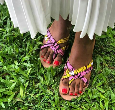 ankara slippers on red nail polished feet