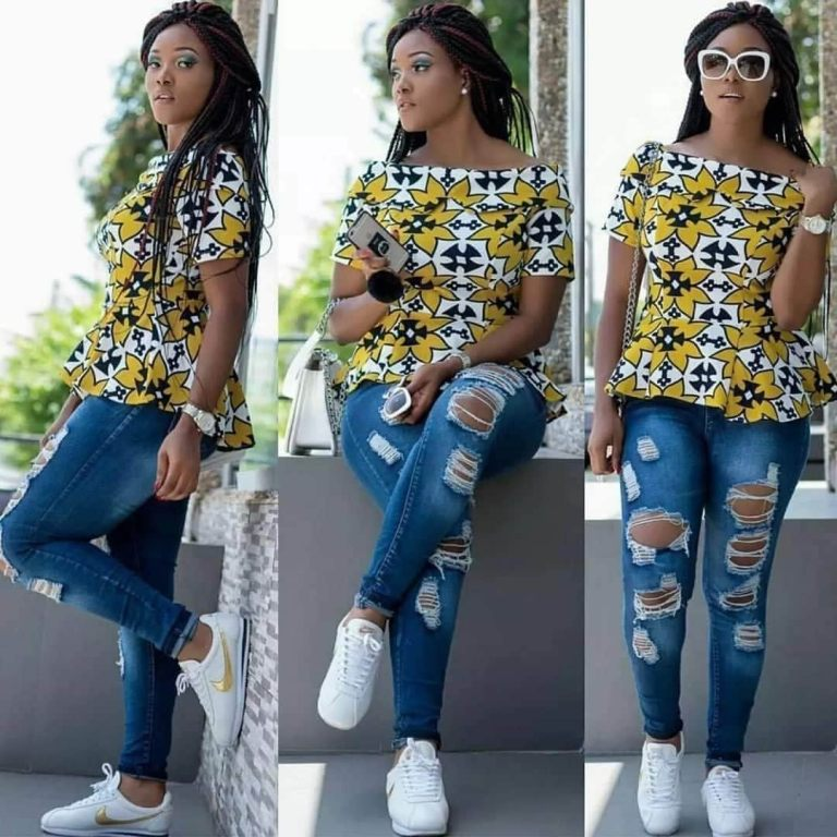 lady in ankara top and white sneakers