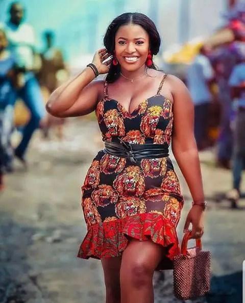 lady in isi agu short dress
