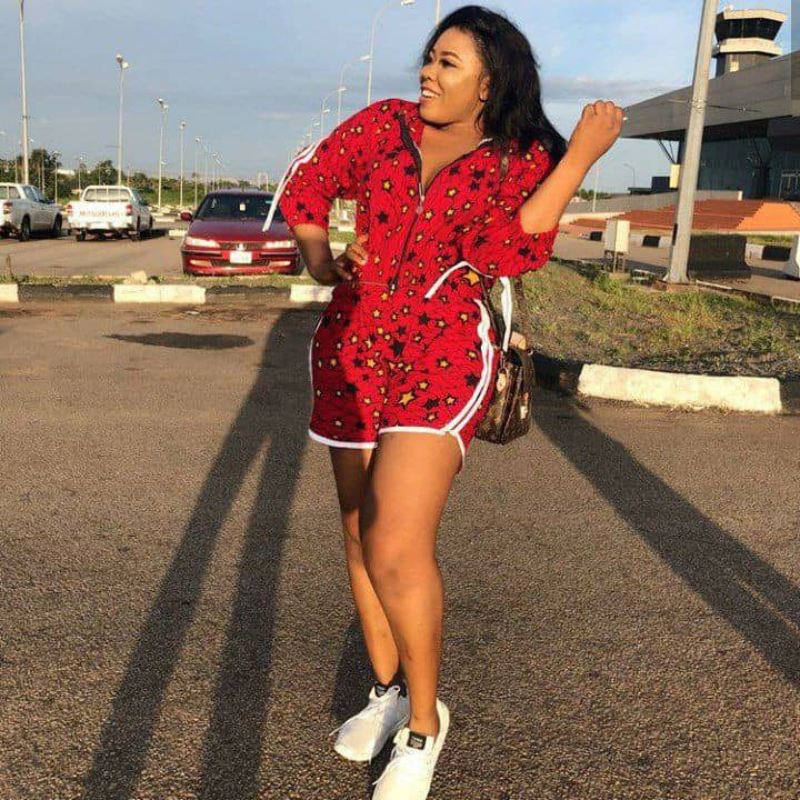 lady in playsuit ankara on white sneakers
