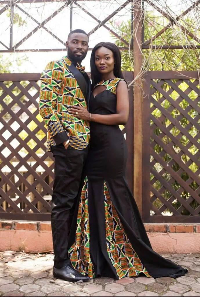 Man wearing kente suit with woman wearing kente designed gown