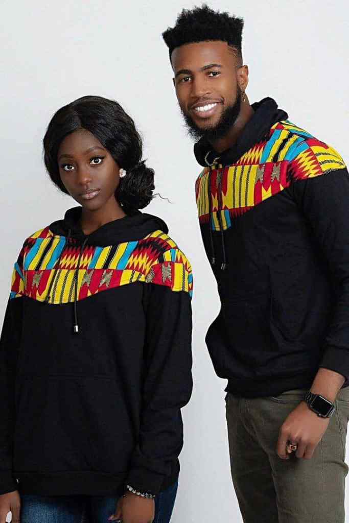Boy and girl rocking matching kente designed sweatshirts