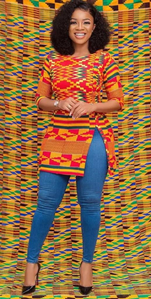 Smiling lady wearing kente top