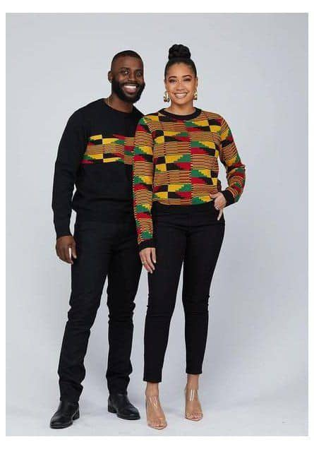 Black couple wearing kente in an Afro urban fashion sense