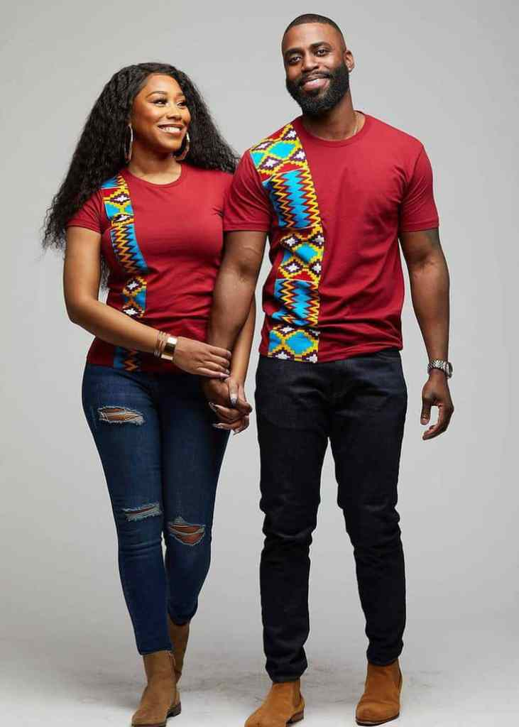 Couple wearing kente designed tshirts with jeans
