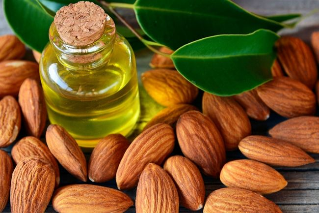 almonds and almond oil in a bottle
