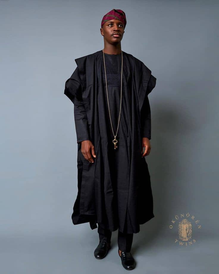 man in black long sleeves agbada