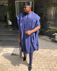 man in a blue short sleeves agbada