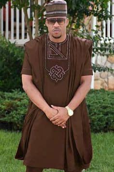 man in brown short sleeves agbada