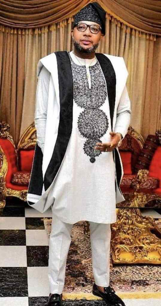 man wearing white and black embroidered agbada