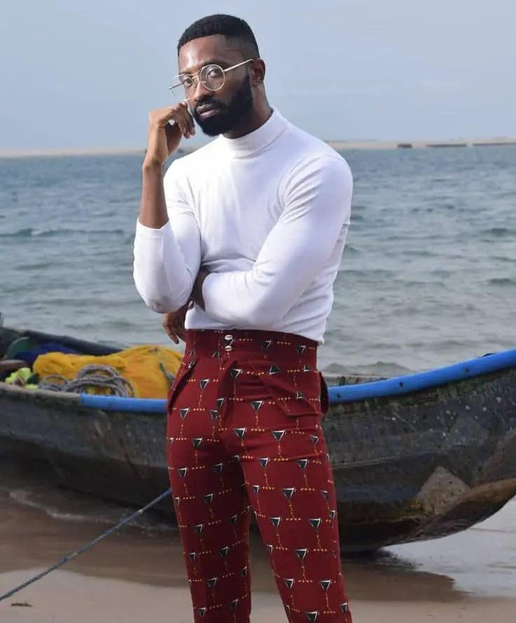 Rick Hassani rock a white turtle neck shirt and ankara trousers