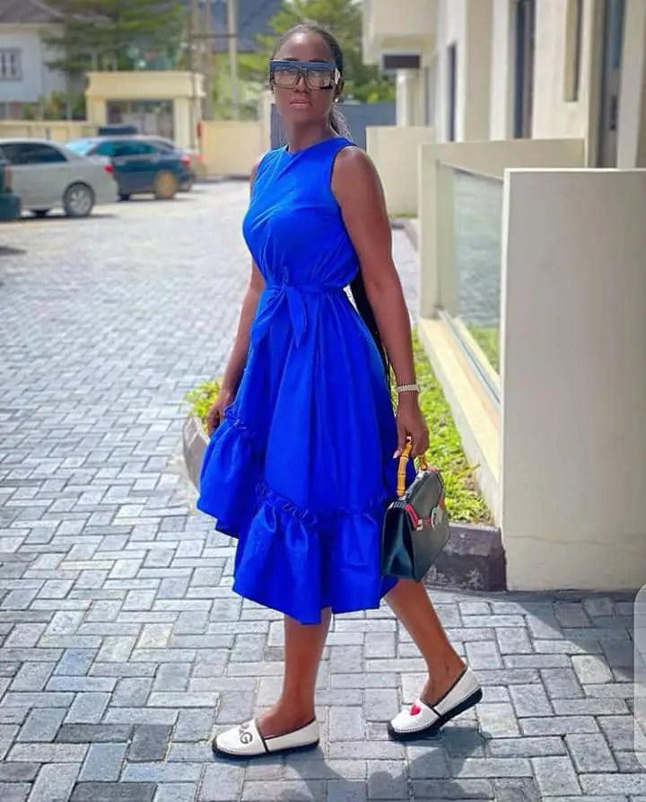 Tolu Bally in a blue dress