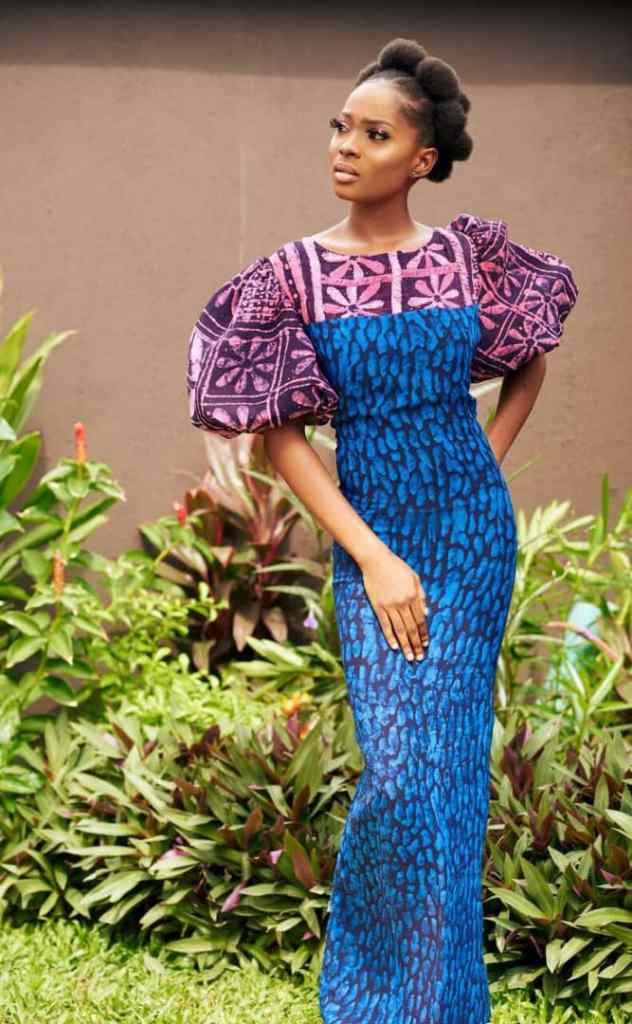 woman wearing a mix and match adire dress