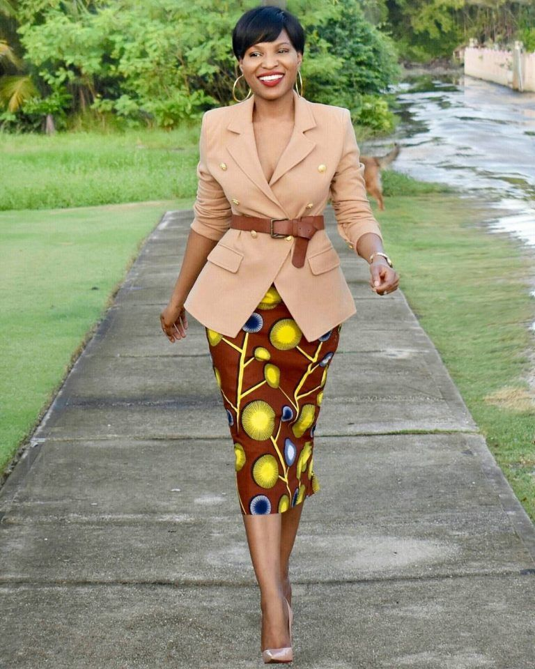 lady wearing ankara midi skirt to work