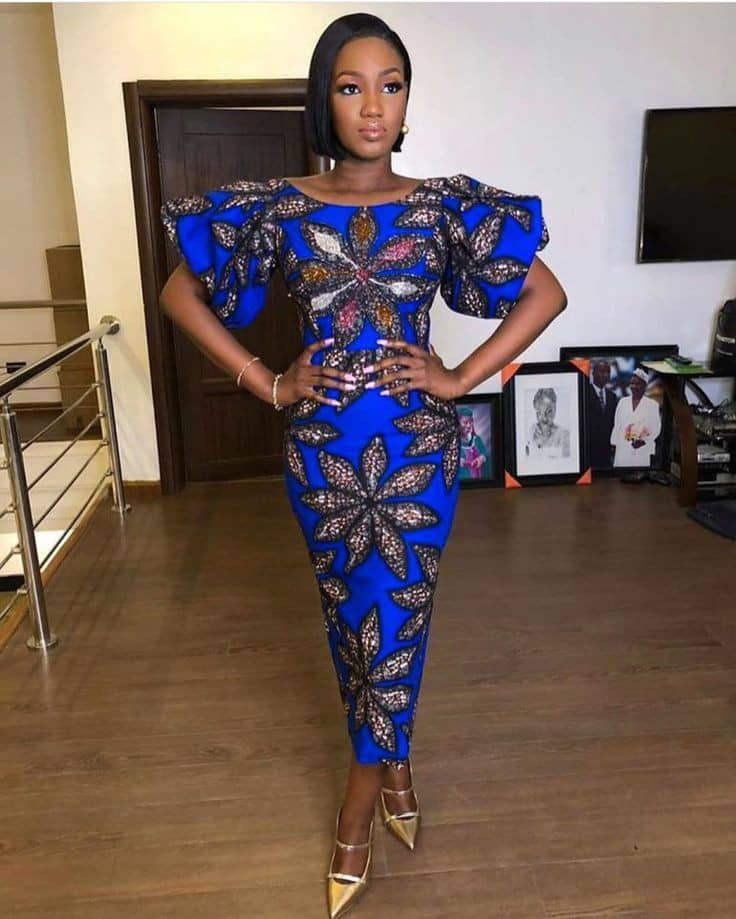 Lady wearing blue ankara long dress