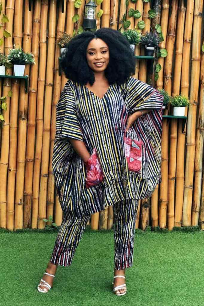 woman wearing matching adire agbada and trouser