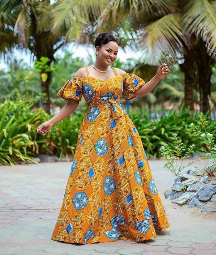 smiling lady wearing a beautiful ankara long gown
