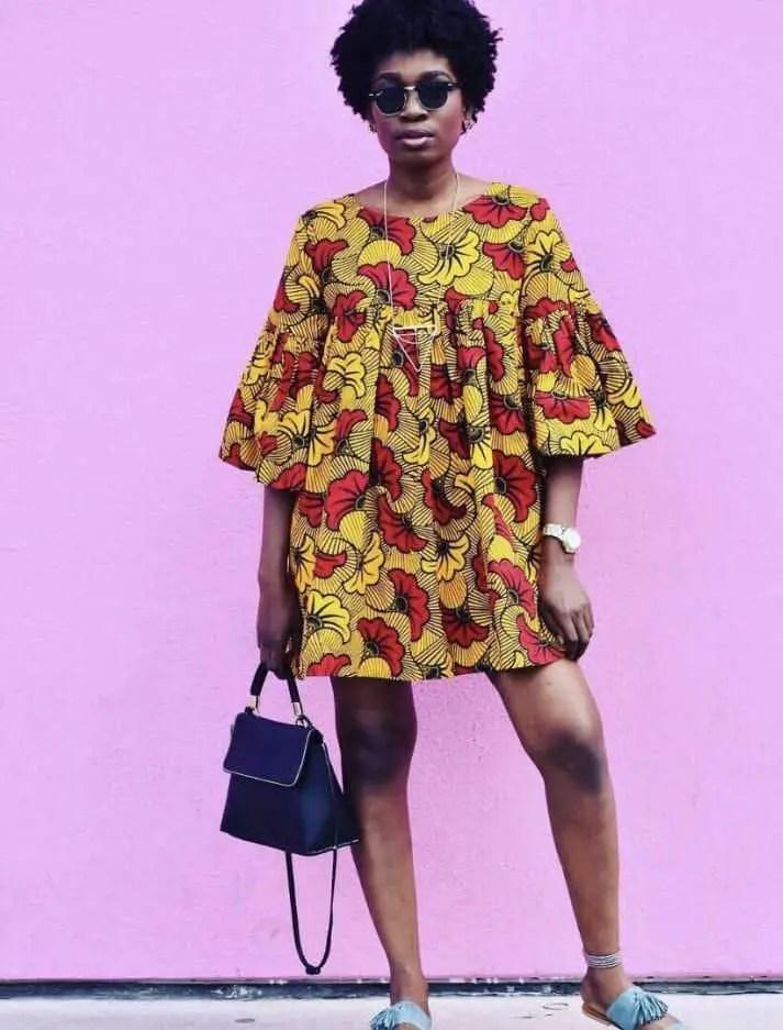 lady wearing a short loose ankara dress