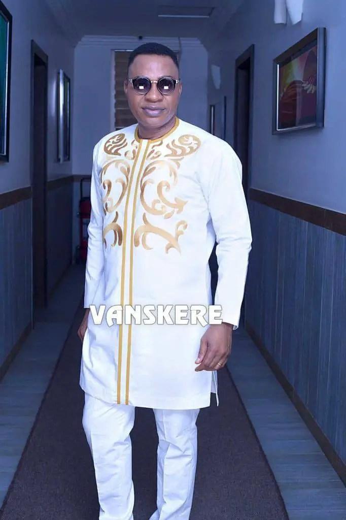 man wearing white embroidered senator