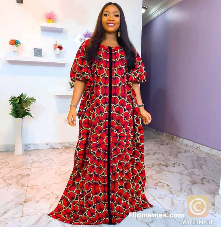 lady wearing flowing ankara dress