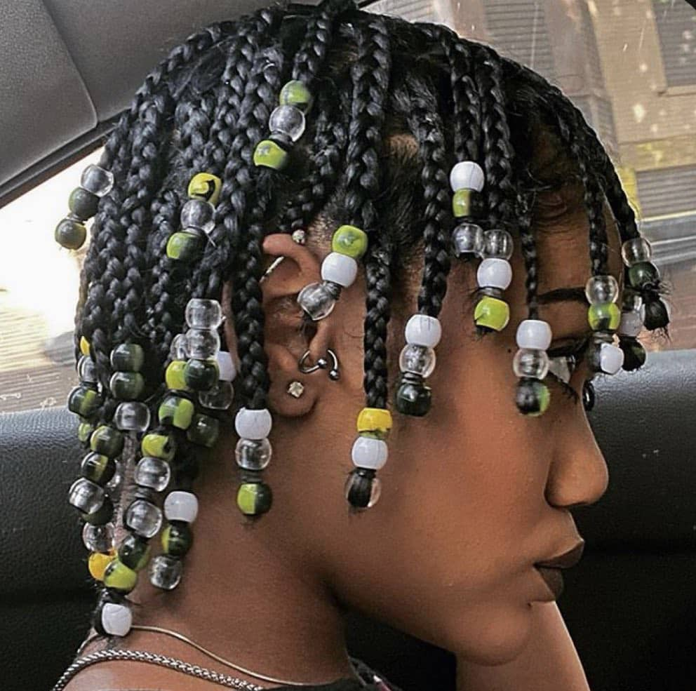 lady's short braids with beads