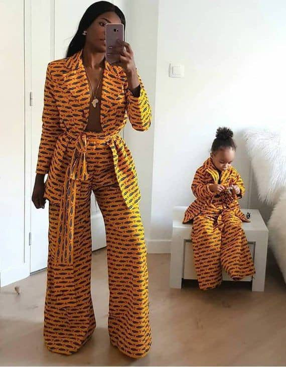 mother and daughter wearing matching ankara suits