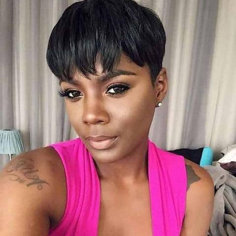 pretty lady wearing black pixie cut for Christmas