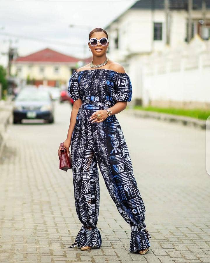 lady in print jumpsuit