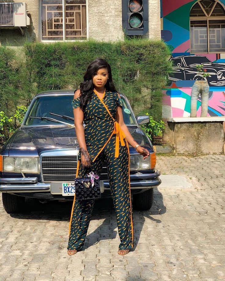lady wearing a stylish ankara jumpsuit
