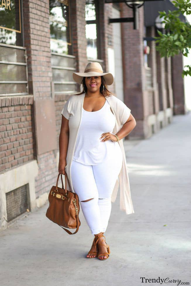 lady in white outfit with brown hat and bag