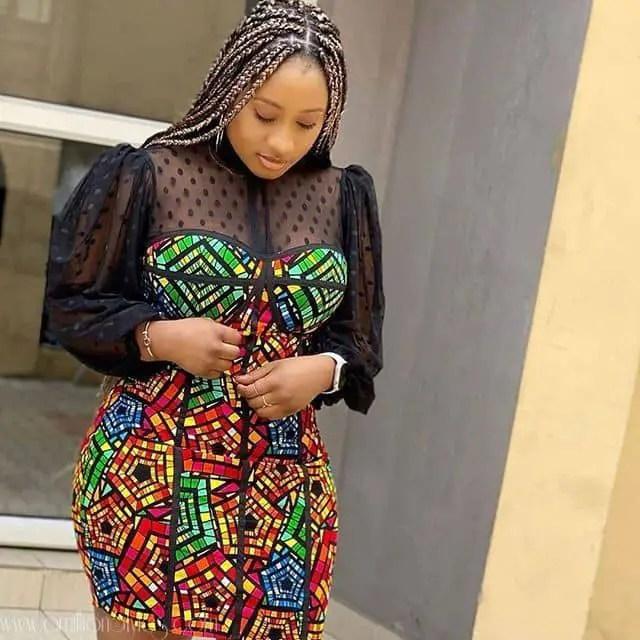 lady in ankara and black net dress