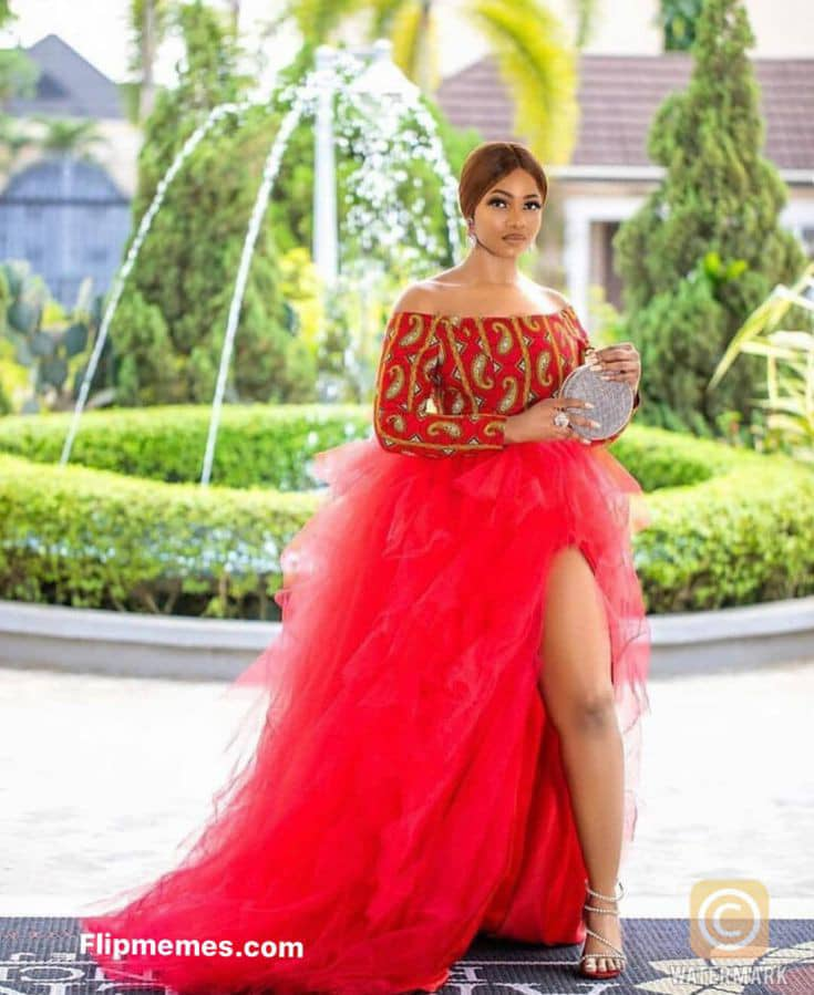 lady in ankara and red net long gown