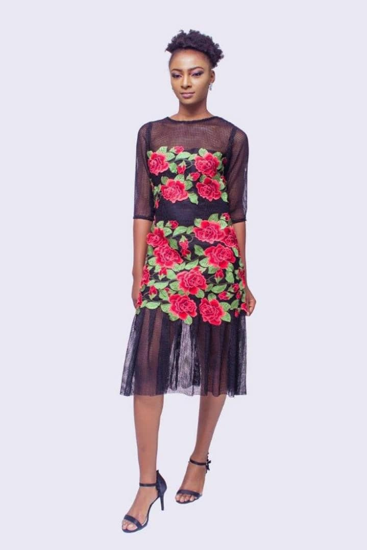 lady wearing a dress made with ankara and net