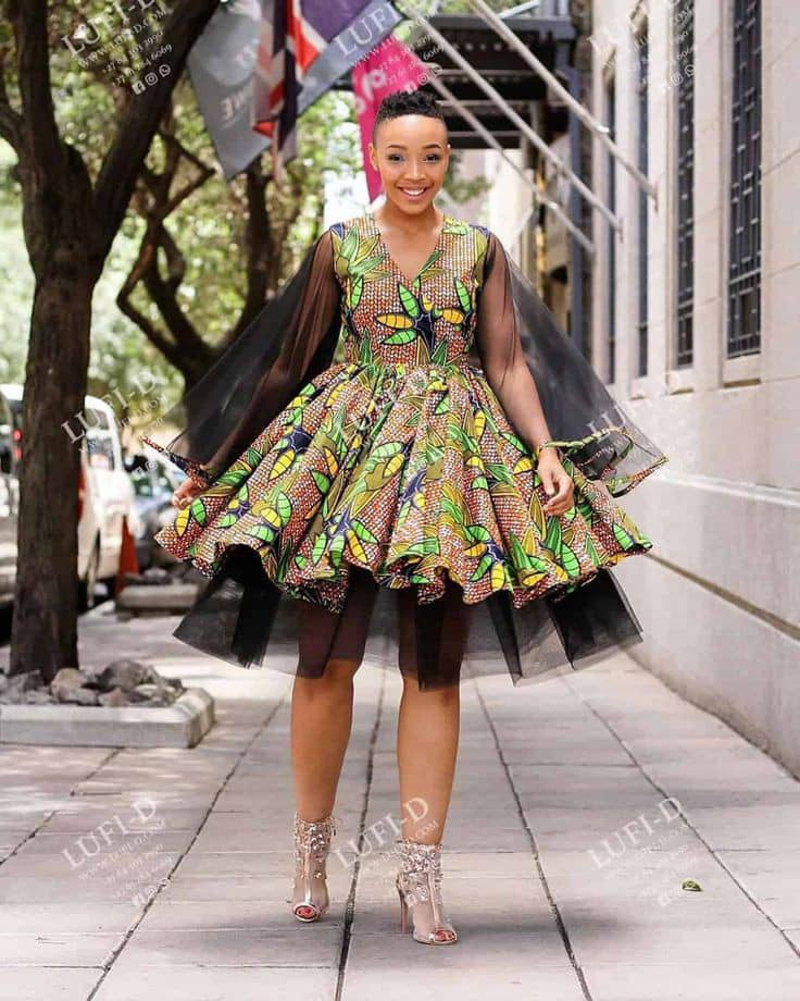 lady rocking ankara dress combined with black net